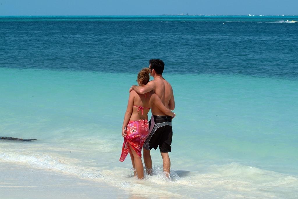 Couple walking the Caribbean beach