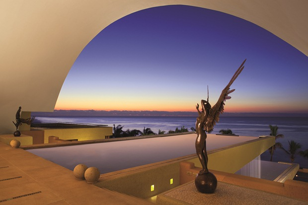 Secrets Marquis Los Cabos at sunset as seen from the resort's beautiful lobby
