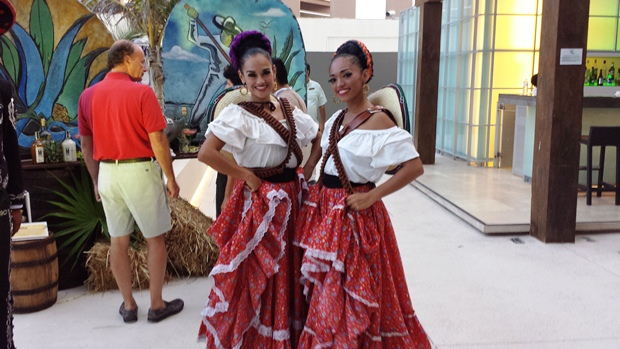 Two women posing in traditional outfits from the Mexican Revolution at Secrets The Vine's anniversary celebration