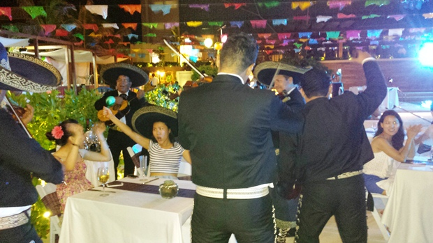 Mariachias playing for the guests at Secrets The Vine's <br>2nd year anniversary celebration