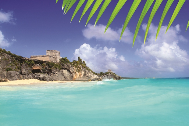 The ruins at Tulum as seen from a boat off the coast of the Riviera Maya