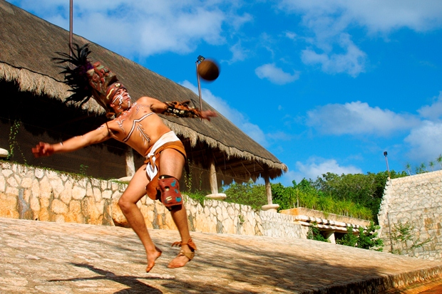 An actor performing the game of pelota at Xcaret in the Riviera Maya, Mexico