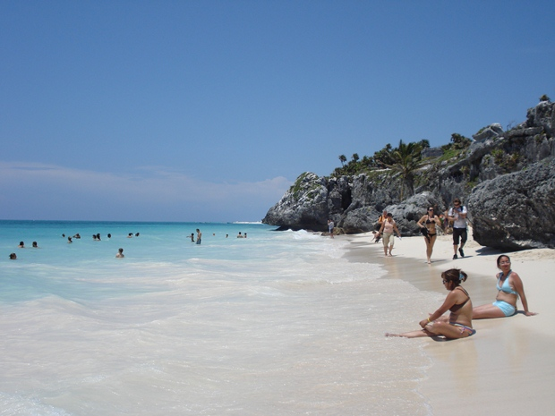 Vacationers enjoy the beach just in front of the Maya ruins of Tulum, Mexico