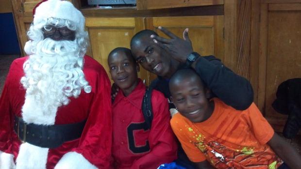 Santa Claus taking some time to greet children in Jamaica