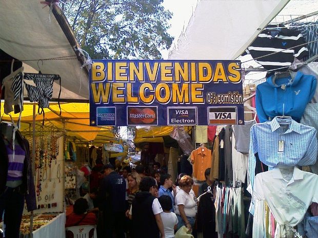 A welcome sign hanging above market stalls in Tulum, Riviera Maya, Mexico