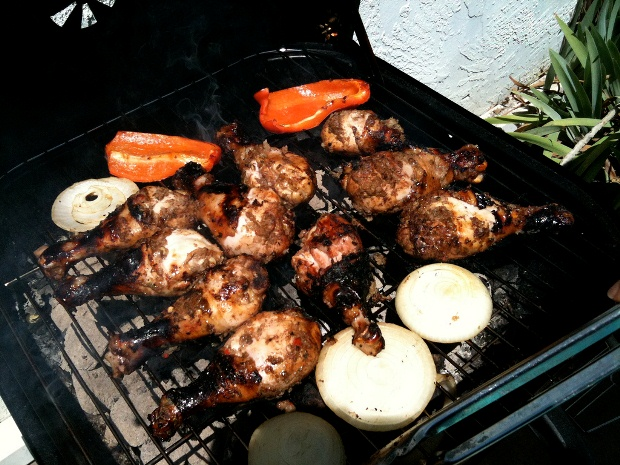 A grill filled with delicious jerk chicken in Jamaica