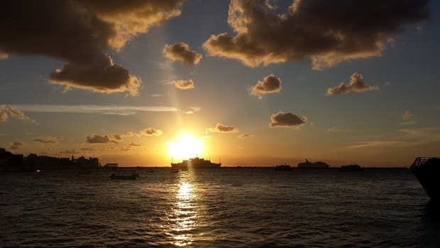 The sun sets on the Caribbean as a ferry takes passengers to Cozumel Island in the Mexican Caribbean