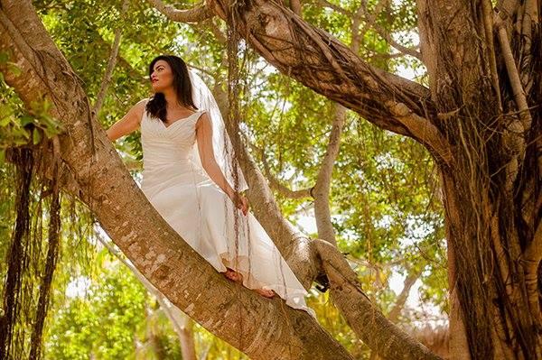 A bride-to-be up in a tree at a photo shoot in the Riviera Maya