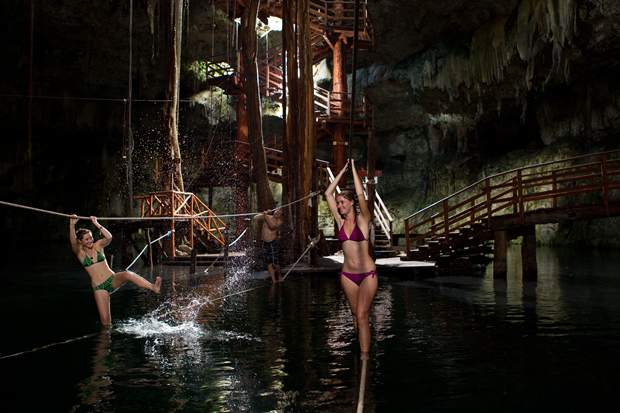 Two women gliding on a zip line during the Ek Balam tour to the Cenote Maya in the Yucatan Peninsula, Mexico