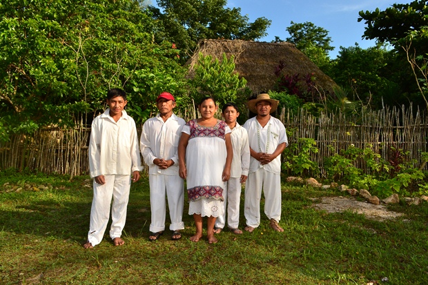 A Maya family poses in front of their hut along the road to the Ek Balam tour