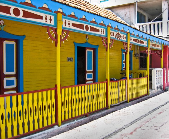 A colorful yellow and blue painted house on Isla Mujeres, Mexico