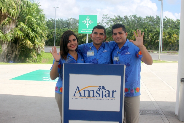 Three Amstar reps waiting for their clients at Cancun International Airport