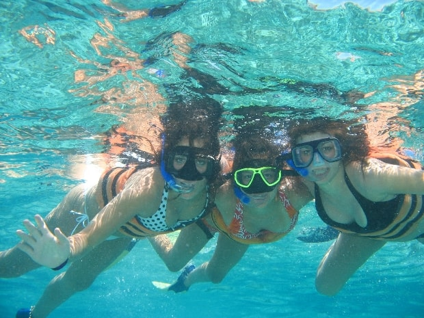 A group snorkeling in the Caribbean Sea