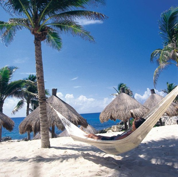 Relaxing on a hammock overlooking the Caribbean Sea on the Amstar dmc tour of Xcaret Park