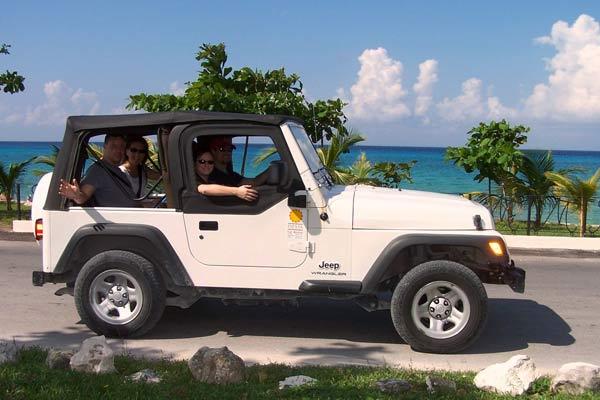 Tourists take a jeep tour of Cozumel Island, Mexico