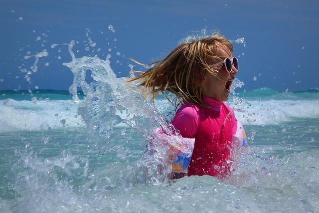 A child splashes around in the Caribbean Sea at Bayahibe beach in La Romana, Dominican Republic