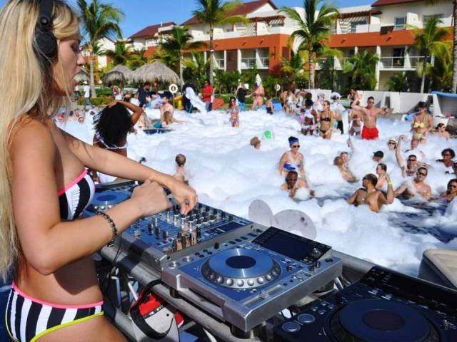 A gorgeous DJ spins the tunes at a foam party during #SexySeptember at Breathless Punta Cana