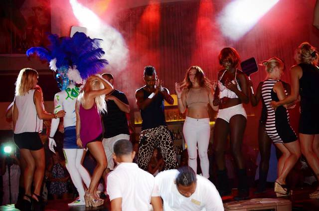 Guests and entertainers at Breathless Punta Cana getting down to some funky tunes during #SexySeptember