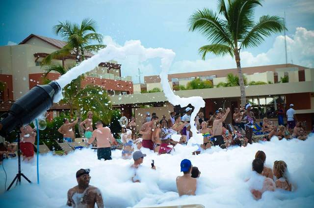Guests at Breathless Punta Cana partying at a foam pool party during the adult-only resorts #SexySeptember DJ events