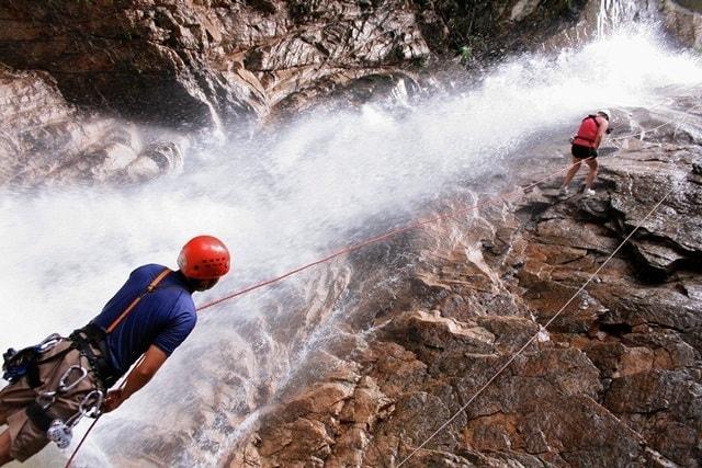 Adventurers rappel down a waterfall in Vallarta