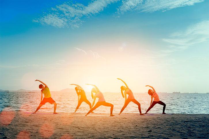 punta cana group beach yoga activity